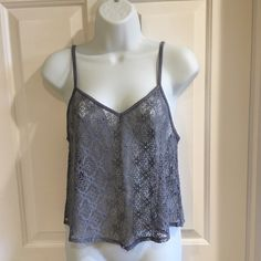   American Eagle   Cropped Lace Tank Brand new with plastic tag attached. Never been worn. Excellent condition. Grayish blue in color. American Eagle Outfitters Tops Crop Tops