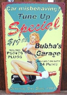 """Vintage BUBBA'S GARAGE Sign SPARK PLUG Pin-Up Girl Tin by OWI. $19.95. Product dimensions 10"""" x 16"""". Brilliant color graphics. Pre-drilled holes for hanging. Aged appearance, although surface is smooth with no actual distressing. Metal sign with rolled edges. You are viewing a Vintage Looking, Automotive Repair Advertising Sign. It is BRAND NEW and made of metal. This innocently naughty sign is in excellent condition with vibrant color graphics and measures 10 inches wide by 1..."""
