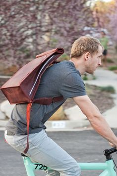Everything a modern man needs. Space for stuff. Check. CEO level style. Check.     Leather Biking Messenger Bag by jrawldesign on Etsy. $265.00 USD, via Etsy.
