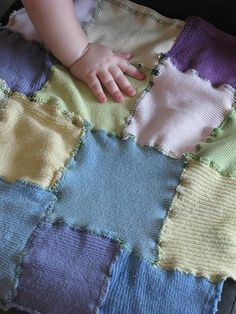 Recycled socks baby blanket. We cut off the sock ankles and opened them up to make squares and rectangles. We used a stitch that was a zigzag with lines on both sides (It probably has a special name, but I don't know it!) to hold the pieces together, and then went all the way around the edge, too.