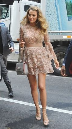 Blake Lively's pregnancy style is so on point. Here she is in New York City showing off a lace mini dress, loose curls, a ladylike bag and strappy sandals -- the most feminine street style outfit ever.