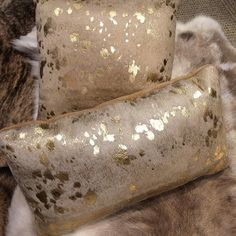 Gold acid-washed #cowhide #pillows.  Elegant.  Earthy.  Rustic. #homedecor #homestyle #homedesign #homedecoration #homeinspiration #cowhiderug #mensstyle #neworleans #frenchquarter by wehmeiers