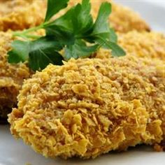 Best Chicken Ever!!!  This dish is made with a sour cream/cornflake crust. Tasty twist!