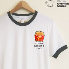 This cute design makes us laugh every time ! We really do love our fries ! We use authentic American Apparel ringer tees. Our ringer tees are a staple to any girl's closet, adding a touch of grunge. They look great styled casually with jeans and boots, or dressed up with a cute plaid skirt. Unlike other Poly-Cotton t-shirts on the market, ours is made with combed cotton, giving it an ultra soft, worn in feel and superior drape. More sizing and composition info here.