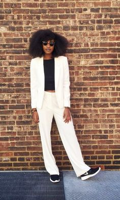 Contrast a chic white suit with a black top