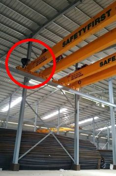 An ironic name for a crane company - not the best way to inspect or repair an overhead crane!