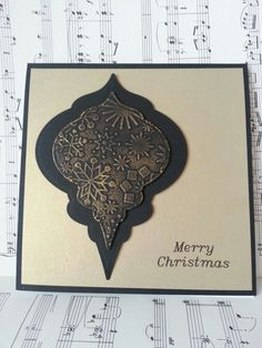 handmade Christmas card ... black and gold ... heirloom bauble 2010 ..  some texture embossing and some gilding wax ... elegant look ...