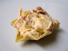 """Cheddar Bacon Ranch Dip  16oz sour cream  1 packet Spicy Ranch dressing mix (or """"regular"""" Ranch mix)  3oz real bacon bits (don't use Bacos)  1 cup shredded cheddar cheese  Combine sour cream and Ranch dressing mix. Stir in the bacon bits and cheddar cheese. Cover and chill for 24 hours, then serve with chips or cut vegetables.  Commenter says: This dip is amazing! It reminds me of a baked potato!"""