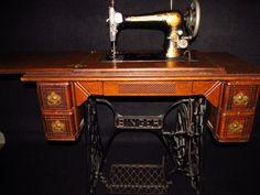 1904 Singer 27 Egyptian Sphinx Sewing Machine W/Tiger Oak Treadle  in working condition, excellent shape Asking $500