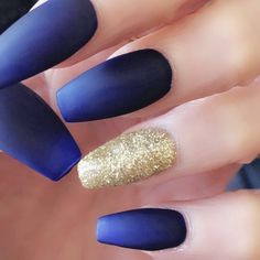 Loving my new acrylics coffin shaped blue and gold glitter didn't get the jewels because of all the weight lifting but I love them  #acrylicnails #nailart #nails #nailsofinstagram #nails #fitfam #naildesigns        Trend Trendy Nails Makeup Beauty Party Style