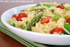 I served this lemony orzo with asparagus & tomatoes hot, but I suspect it would be just as good cold! Fits Italian menus perfectly. Make it for a side dish... eat it as the entree! It's that good.