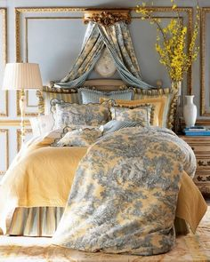 use of accessories to blend the toile in with the room--white vase, light colored lamp, yellow flowers