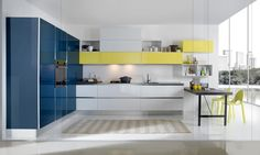 Modern kitchen cabinets from the Aran Cucine Bijou collection. Custom built in Italy in a variety of natural, lacquered, and painted finishes.
