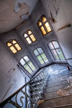 abandoned hospital stairway.