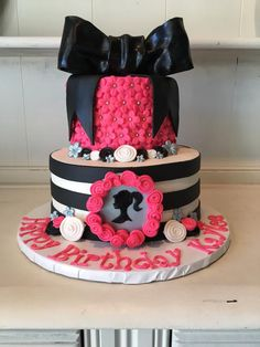Super Fun Hot Pink Black and White Barbie Cake With A Present Bow