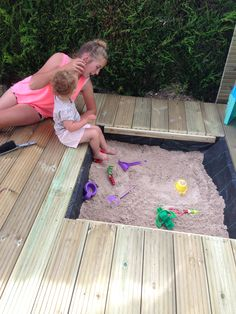 an integrated sandpit, which could be covered by the deck planks when not in use