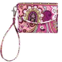 Vera Bradley very berry paisley supersmart wristlt This is a brand new with tags Vera Bradley very berry paisley wristlet. It has a pocket for your I phone 4 and an id window with 3 card slots, money slot and snap closure. The wristlet strap is removable and can be used as a wallet. Vera Bradley Accessories