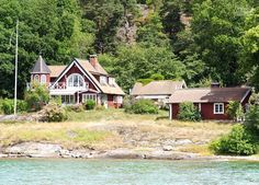 One of the many fairytale-like cottages you'll see on the way to Stockholm - Cruising Attitude Sailing Blog | Discovery 55