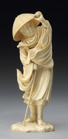An fine ivory okimono of a mendicant monk Meiji Period, Signed Komei (Ishikawa)