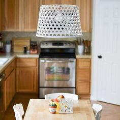 A design-forward DIY light fixture using a $10 IKEA basket and some spray paint.