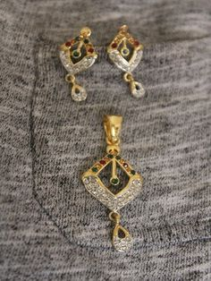 Diamond shaped earrings with diamond work - Sweta Sutariya
