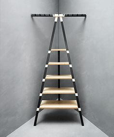 These IKEA PS 2014 wall shelves and hanging pegs can be stacked with dishes, filled with books or loaded with shoes and coats. Move from room to room and use how you like.