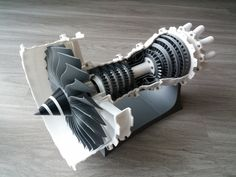 A model of a 2-spool high bypass turbofan. I designed the whole engine from scratch with visual cues to certain existing engines.  For example, I think Rolls-Royce makes the best-looking fans, so there's some resemblance there... By the way, this model was featured on SolidSmack. Several parts benefit from the use of custom supports. I included these supports in the parts as needed, and they are much better than any slicer's default grid-like support structures. However, certain parts...