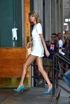 This shining white romper got a boost of color from Taylor's electric-blue heels.