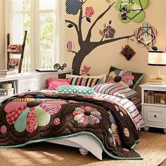 Patchwork-I like the wall picture peg board that mirror the quilt flower pattern. Really cute!