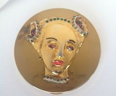 Rarest of the rare figural designs made by Eisenberg Original 1940. Sterling silver womans face with rhinestones all intact! Gorgeous enameled lips and eyebrows! Absolutely stunning and FABulous compact; to die for! This listing includes only the one Eisenberg Original compact described