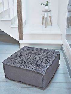 This deeply comfy anthracite footstool has a knitted panel at the top for that home-spun feel. It's the perfect way to kick back and put up your feet after a long day.