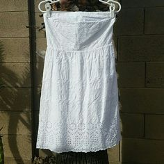 "White Eyelet Strapless Dress Old Navy White Eyelet Strapless Dress. Side zipper. Shell: 100% Cotton, Lining: 100% Cotton. When laying flat, across chest is 15"", waist flares out to about 20"", full length is 30"" long. Side zipper. Worn once, dry cleaned. No rips, tears, flaws, or defects. Comes from a smoke free home. Old Navy Dresses Midi"
