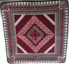 embroidery red pillow with star in the middle