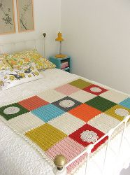 This granny square blanket really lives up to its name. Make an Extraordinary Blanket and be sure to display it - it's that beautiful! Adorned with lacy crochet doily patterns, this easy blanket will be the perfect accent to your room. It will teach you how to join granny squares so that you can get this awesome patchwork look. These giant squares look great in bright, vibrant colors. The Extraordinary Blanket is the best in spring and summer - it will light up your whole house.