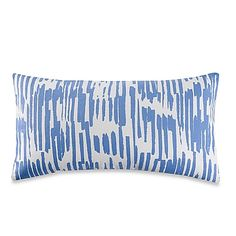 The kate spade new york Paint Drip Throw Pillow features playful cornflower vertical drips along the front of a crisp white pillow. The stylish, oblong pillow brings color, texture and interest to your bedding.