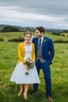 His suit, Her sweater....perfect! Blue + Mustard