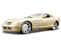 This Mercedes-Benz SLR McLaren Diecast Model Car is Yellow and features working wheels and also opening bonnet with engine, boot, doors. It is made by Maisto and is 1:18 scale (approx. 24cm / 9.4in long).  ...