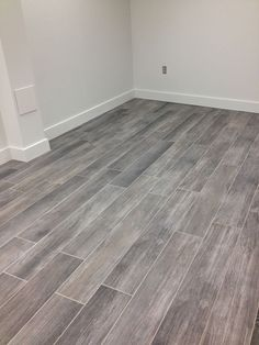 I love a grey wood tile floor!