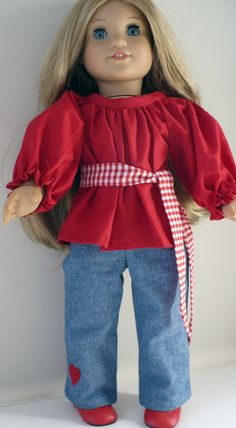 Red top peasant style with sash and blue jeans