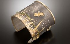 Cuff | Keri Ataumbi. 'Firefly'. Oxidized Sterling Silver, 18 karat gold, 24 karat gold, Fair-Trade Diamonds, Emeralds