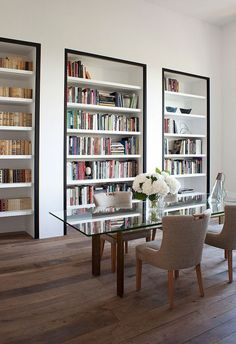 Pierre Yovanovitch: black painted framed bookcases in his Paris apartment