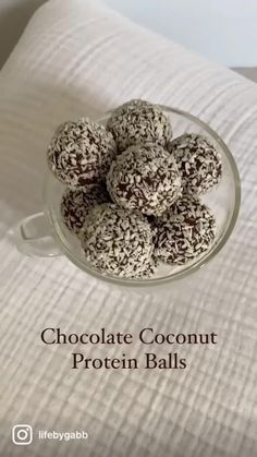 Chocolate Coconut Protein Balls! The perfect little bite of sweetness when you want something chocolatey🍫🥥1 cup almond flour1/4 cup cacao powder1/4 cup chocolate protein powder1/4 cup shredded coconut1/4 cup date syrup1/4 cup maple syrupPinch of saltMix all ingredients together until combined. Place in freezer for 60 min. Roll into balls + shredded coconut and enjoy !