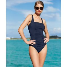 Suit up in style with Calvin Klein's flawless one-piece, featuring a slimming pleated panel!