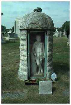 "Calvary Cemetery, Chicago, has this young boy in his own little round ""cubicle"""