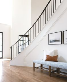 Front entry + entry stairs + black stair railing + curved staircase + long entryway bench + entry be Black Stair Railing, Black Stairs, Curved Staircase, Staircase Design, Black Bench, Staircase Ideas, Stair Design, Grand Staircase, Design Design