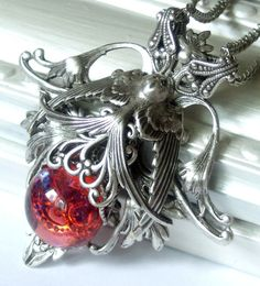 Jeanne's Plight in Silver handmade filigree and dragons breath opal necklace $45