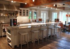 AWESOME wood beamed kitchen.  Really love the mix of contemporary and traditional.