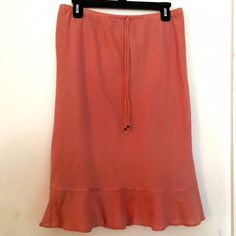 Cute pink skirt from Express. Cute pink skirt. Falls just below the knee. Elastic waist band that can be tainted/loosened  with tie shown in the picture. Used but in very nice condition. Express Skirts