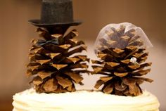 Cute idea for a winter wedding cake topper. Could tie in with pine cones in a bouquet.