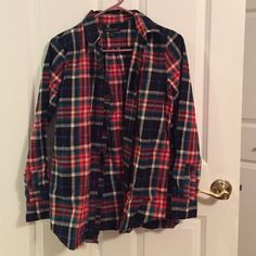 BNWOT banana republic ruffle button down So cute and perfect for winter! Plaid detail with ruffle front on the right side. Ruffle strip on both arms by the wrists. Never worn! All prices negotiable! Banana Republic Tops Button Down Shirts